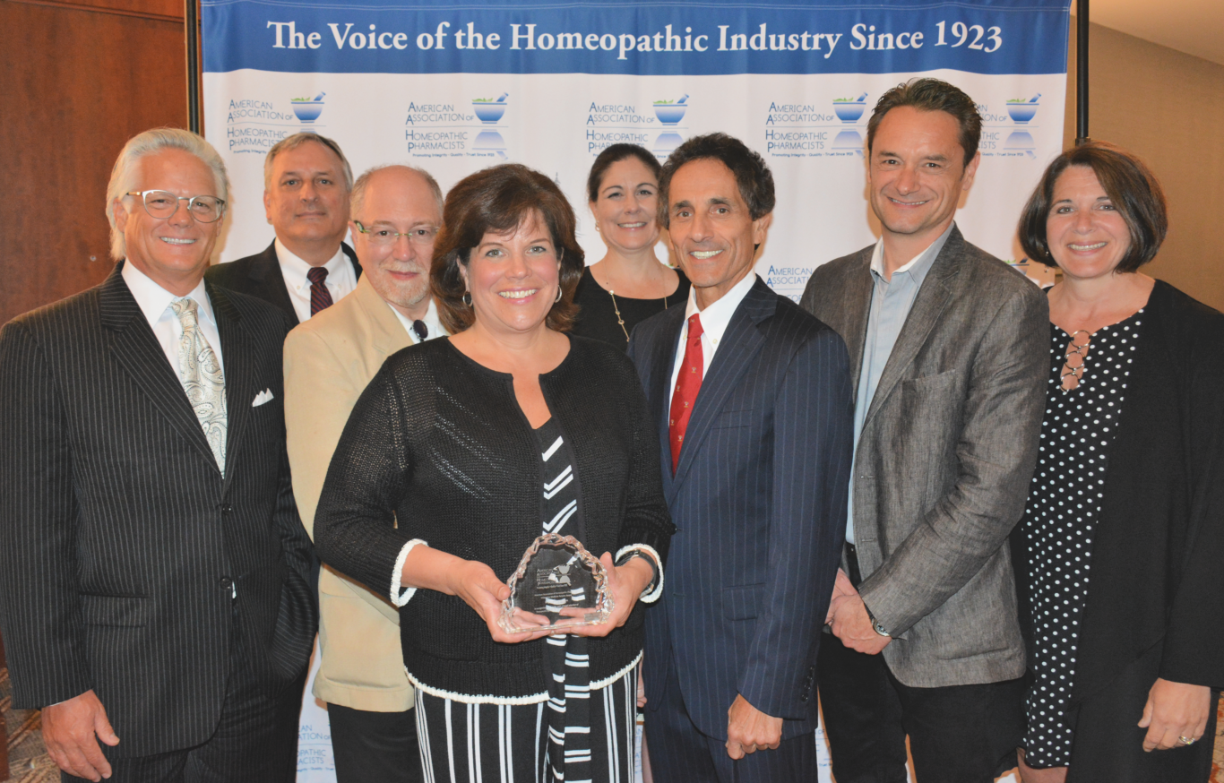 Karen Shadders, Wegmans Food Markets Vice President of Health, Wellness, Home & Entertaining accepts the Integrative Medicine Award from the board members of American Association of Homeopathic Pharmacists at the group's Summit, June 27 in Baltimore.